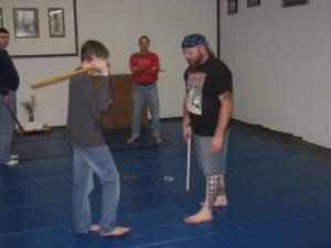 Mikey Taylor instructs Wil Coenen on stick fighting.